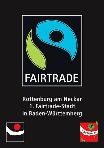 Großes Fairtrade-Logo mit zwei untenanstehenden, kleinen Logos wie das der Agenda 21.