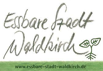 Schriftzug in leicht transparenter grüner Farbe und Blätter.